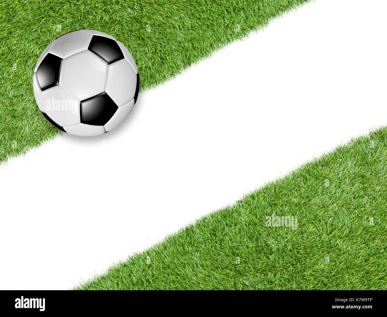 Soccer ball on green turf with a wide diagonal white line through ...