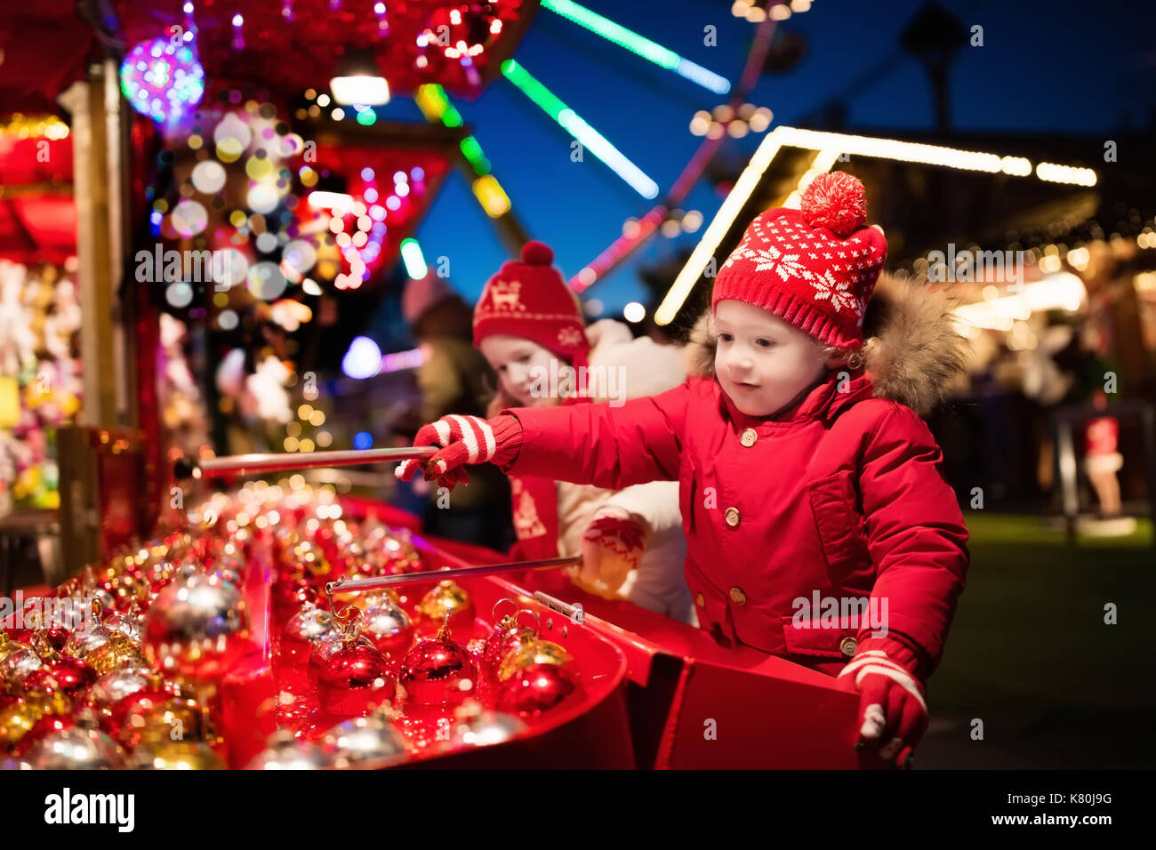 Kids at traditional Christmas fair. Children and Xmas market on ...