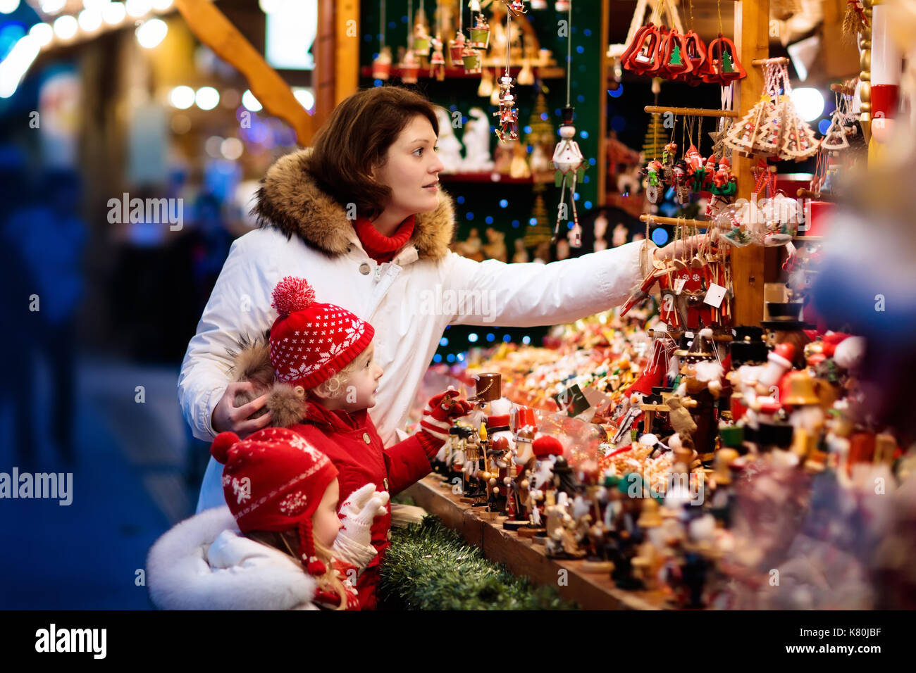 Lovely Traditional German Christmas Tree Ornaments Part - 12: Mother And Child In Warm Hat Watching Handmade Glass Christmas Tree  Ornaments At Traditional German Xmas Street Market. Family With Kids  Shopping For