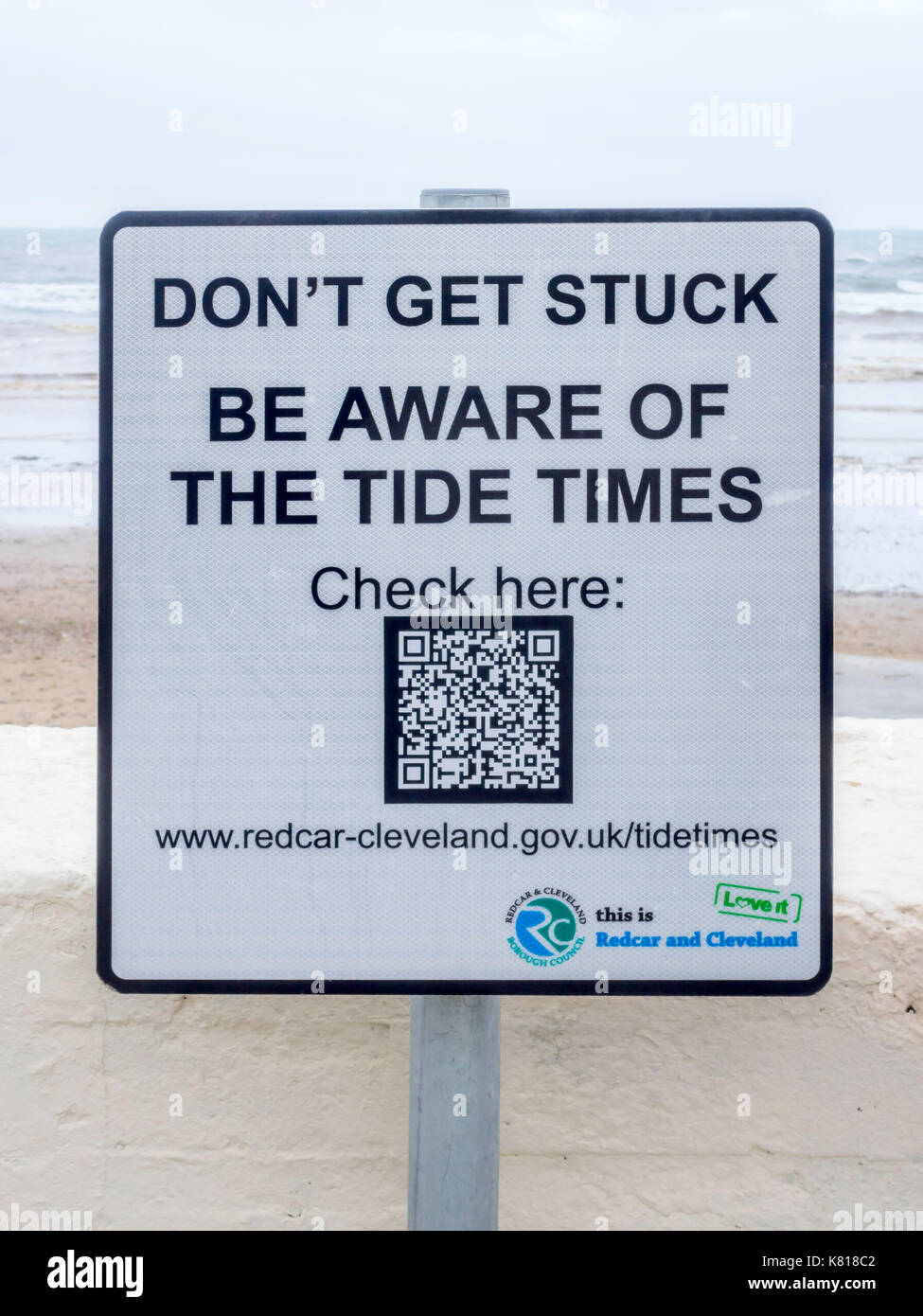 Tide table stock photos tide table stock images alamy notice by saltburn beach at a notorious danger spot warning against being cut off by the nvjuhfo Choice Image