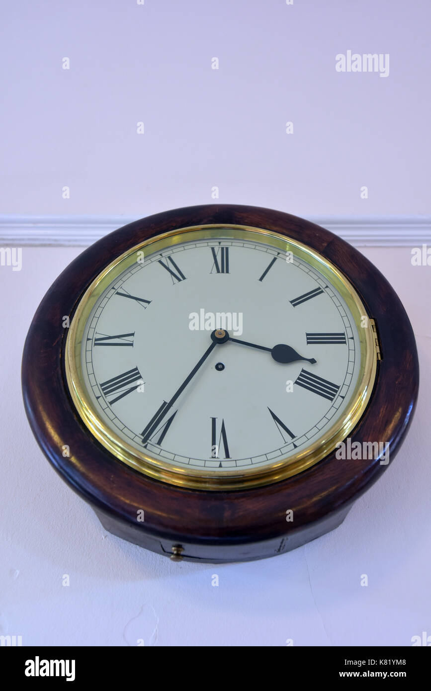 Painted dial stock photos painted dial stock images alamy an old round wooden station clock on the wall of plain painted waiting room with a amipublicfo Image collections