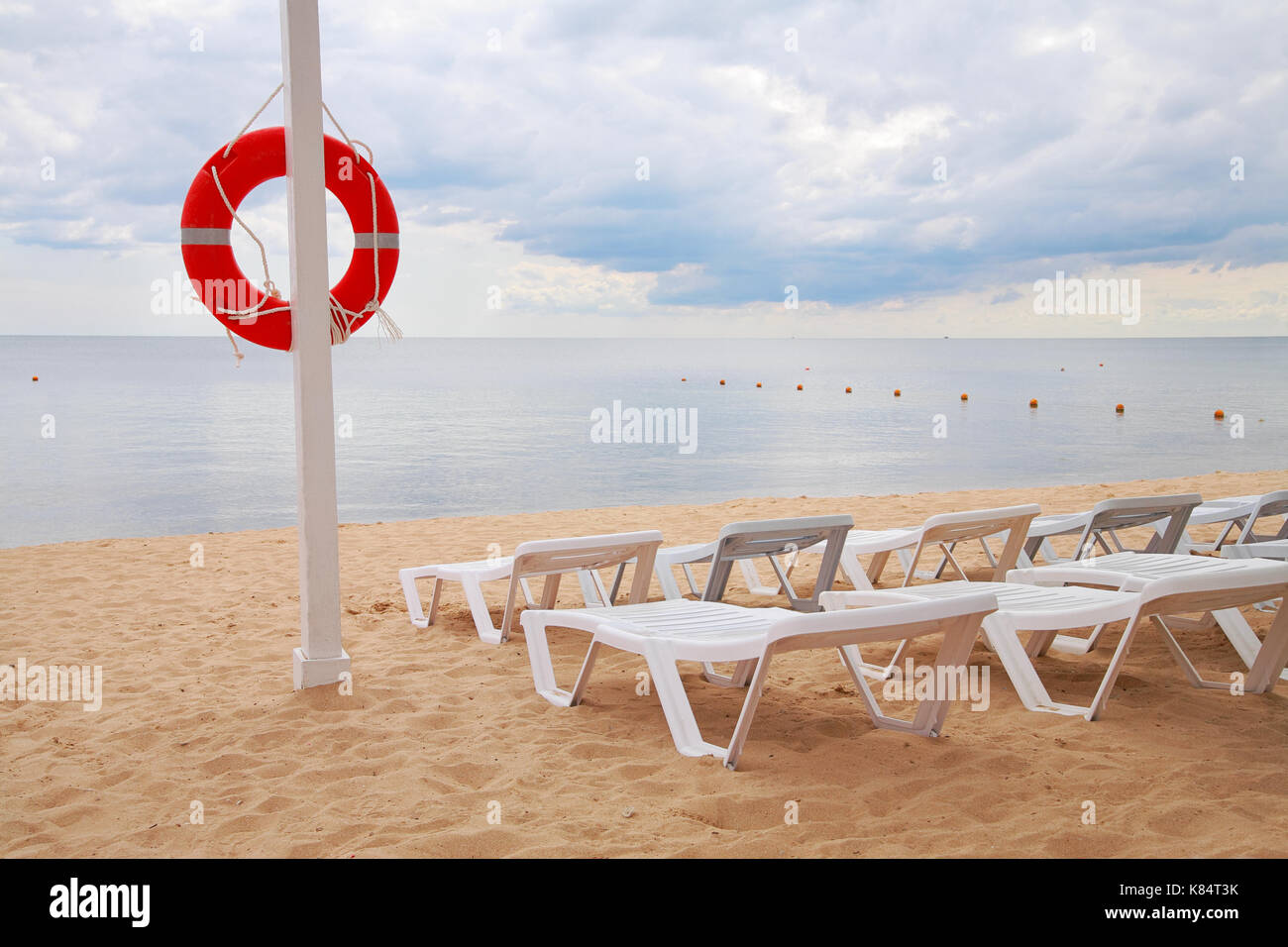 Welcome aboard boat ships life ring clock - Life Ring Hanging On A Pillar And Sun Beds On The Beach Against The Sea