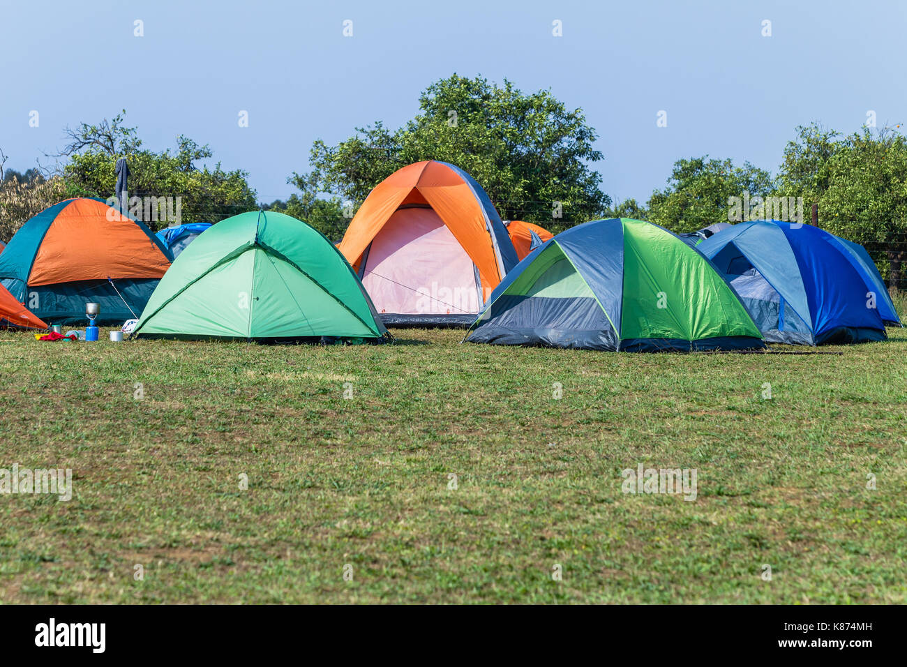 C&ing tents a dozen spread over grass field rural mountain countryside hiking adventures & Camping tents a dozen spread over grass field rural mountain Stock ...