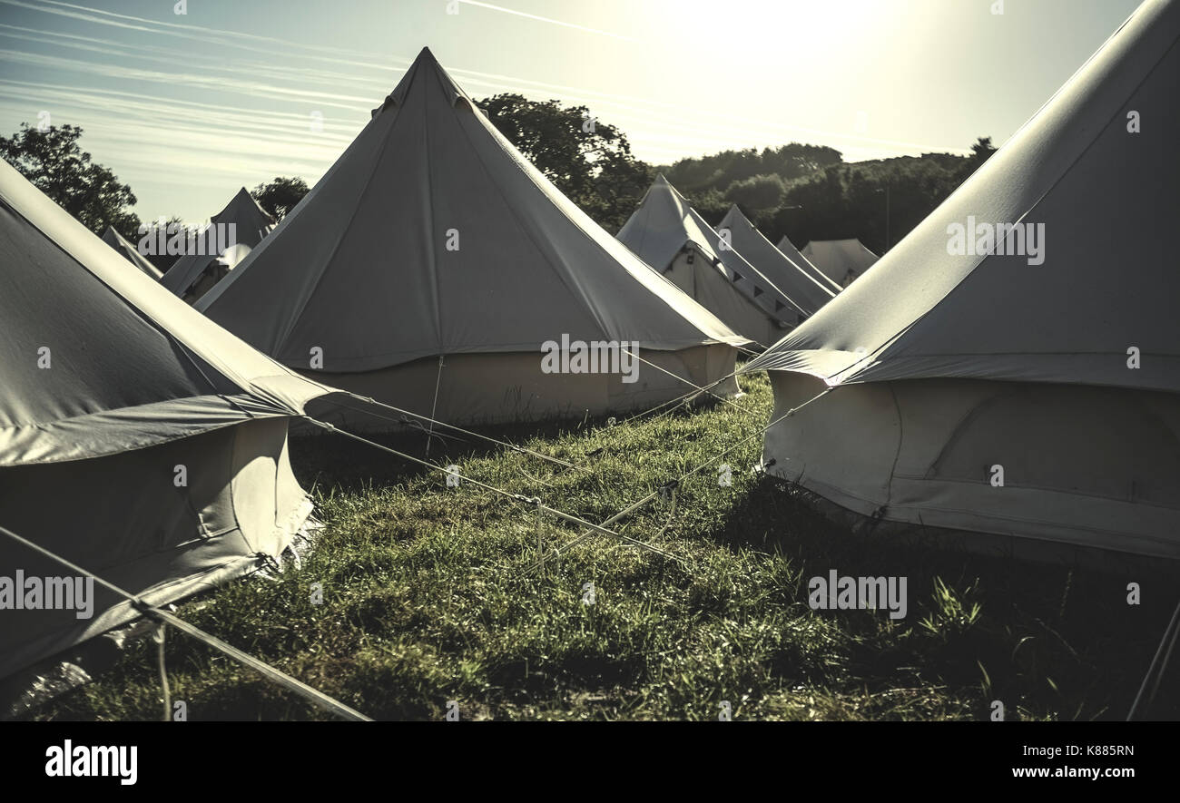 Gl&ing bell tents traditional canvas tents in an enclosure on the c&ing grounds at an outdoor music festival & Glamping bell tents traditional canvas tents in an enclosure on ...