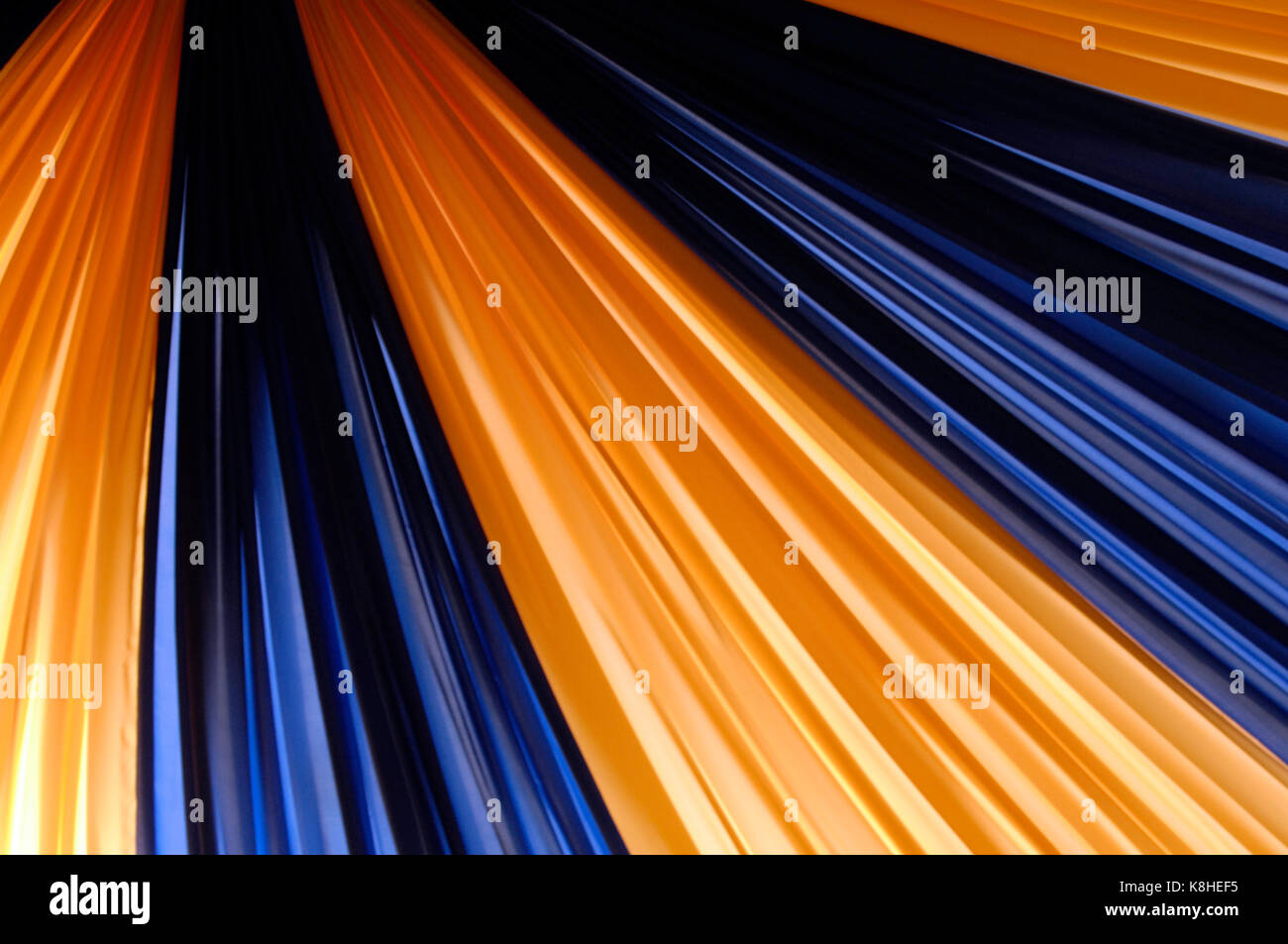 some blue and yellow coloured silk drapes or curtains forming the roof of a tented area & some blue and yellow coloured silk drapes or curtains forming the ...