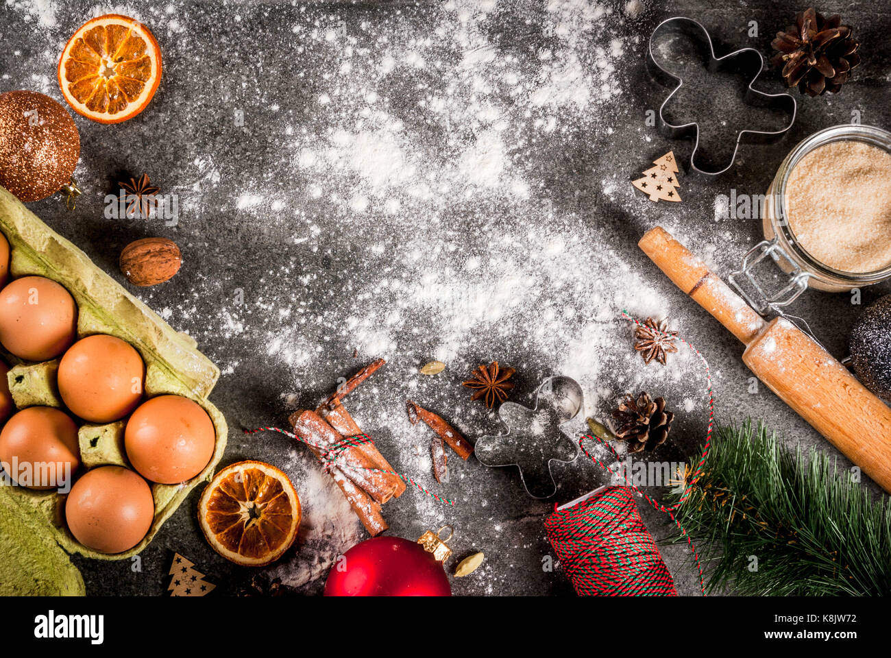 christmas new year holiday cooking background ingredients spices dried oranges and baking molds christmas decorations balls fir tree branch co