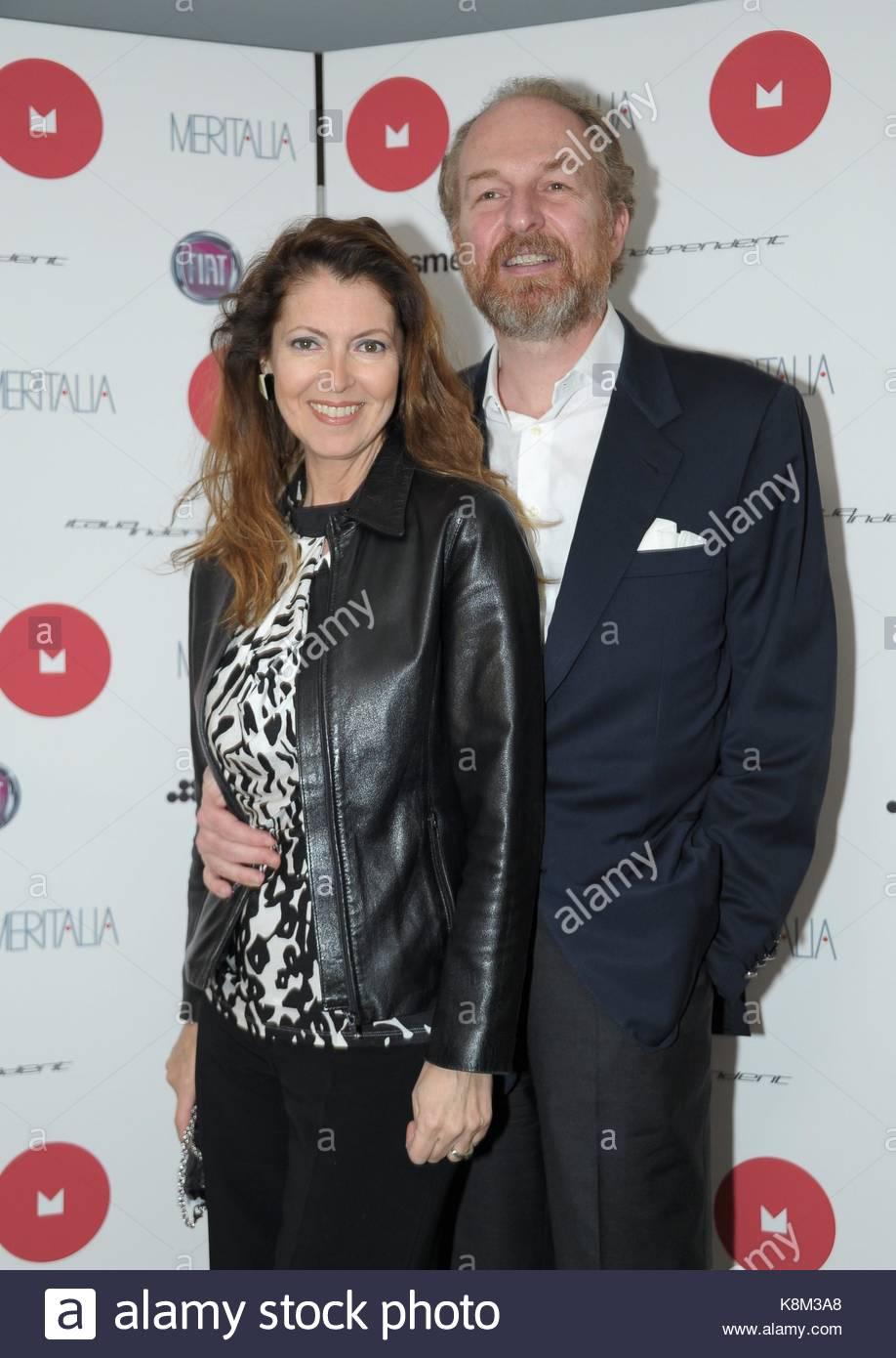 Meritalia Lapo Elkann Presenta Officina : Arturo artom con la moglie milano show room meritalia
