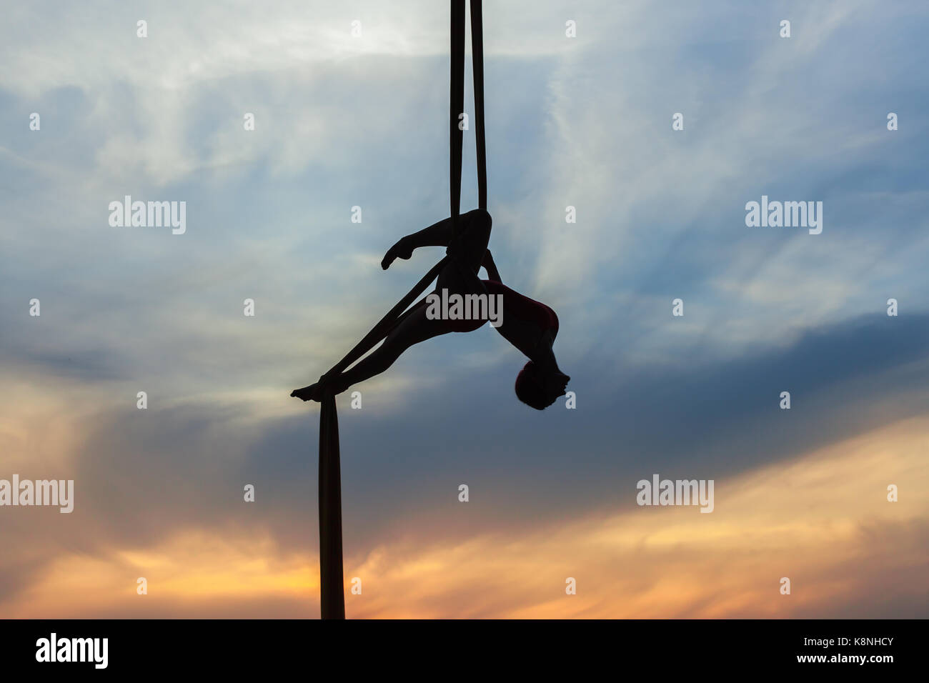 woman in a hammock does tricks against the sky she is an athlete aerial acrobat woman hanging in aerial silk stock photos  u0026 woman hanging in      rh   alamy