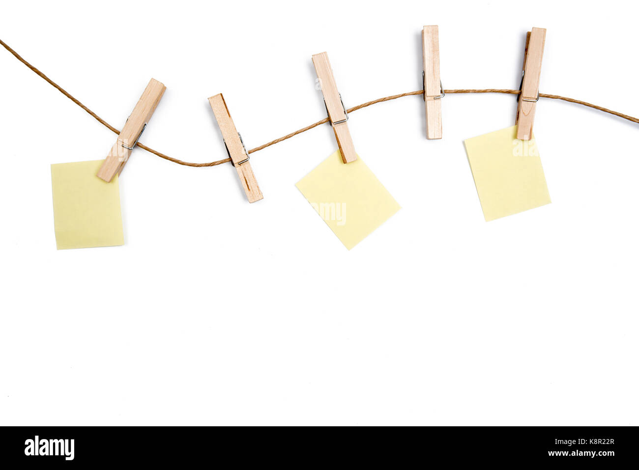 Blank Memo Papers On Rope With Clothespins, On White Backgrounds