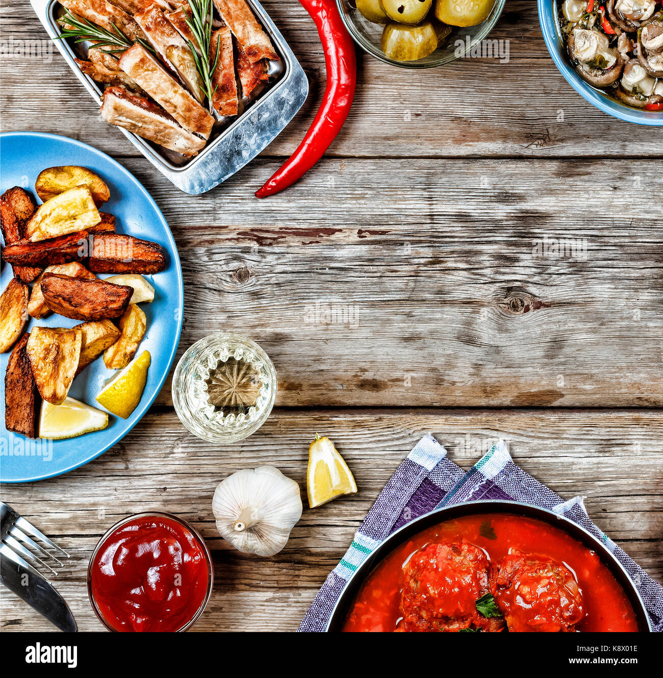 Dining Table With A Variety Of Meals And Snacks Meatballs Baked Potato Wedges Meat Mushrooms Ketchup Wooden Background Top View Rustic Style