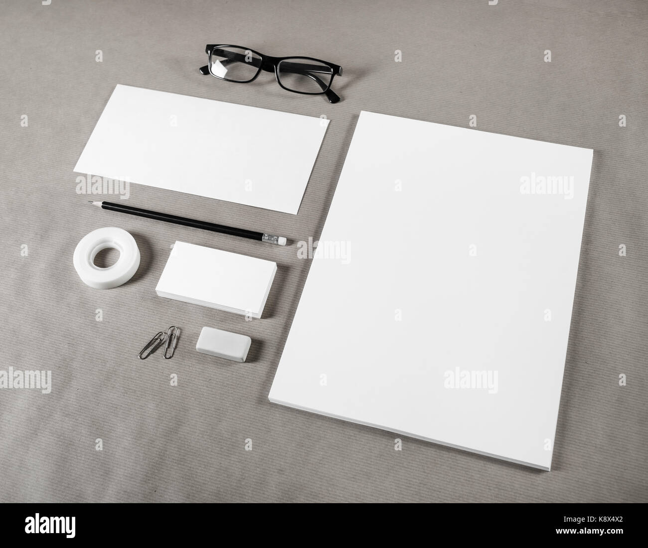 blank stationery set on paper background corporate identity stock