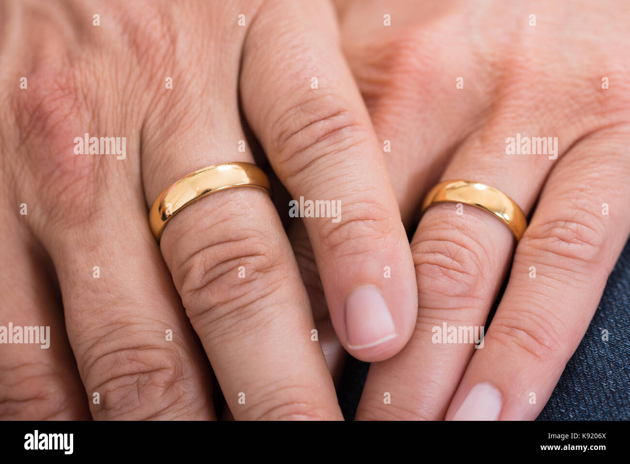 Close-up Of Hands With Golden Wedding Rings Stock Photo: 160469314 ...
