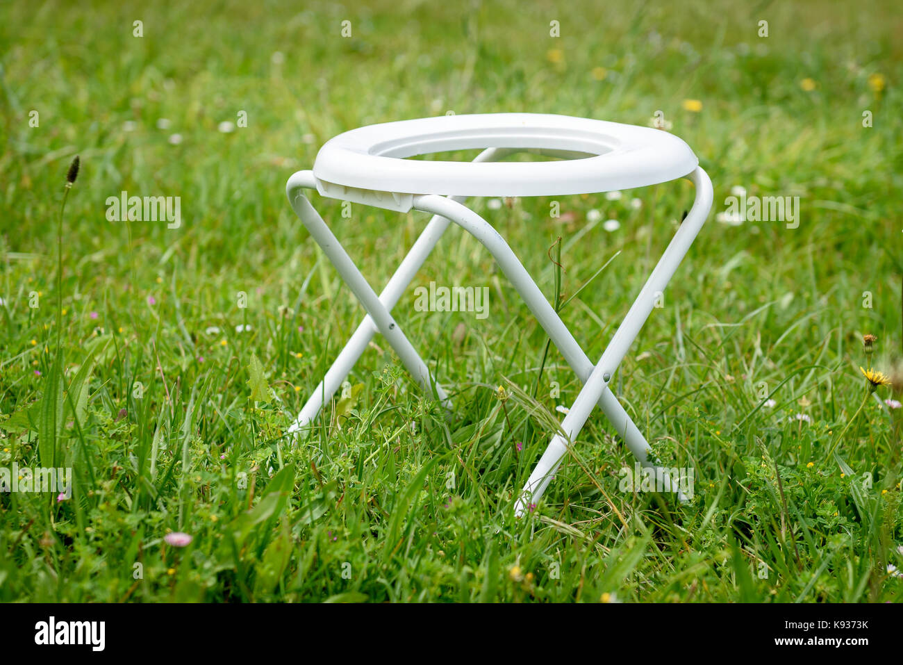 Portable Camping Toilet : Portable folding camp toilet outdoors in the grass. camping or motor