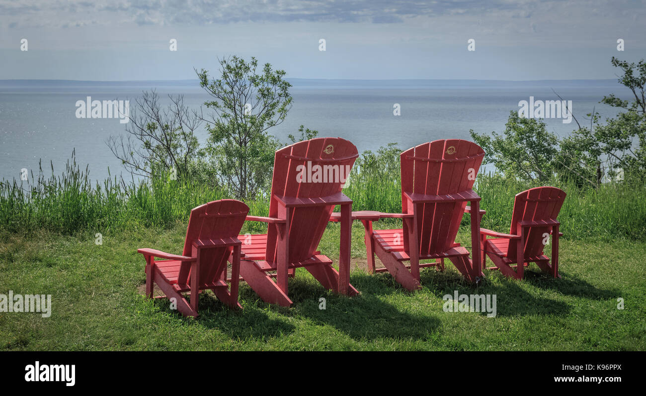 Brightly Colored Outdoor Lounge Chairs Facing Calm Waters Of The Bay Of  Fundy, New Brunswick, Canada