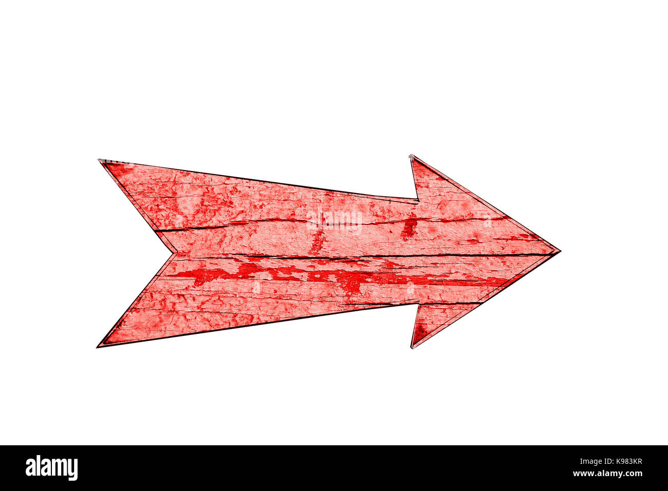 red vintage wooden direction arrow sign on a cracked and peeling red
