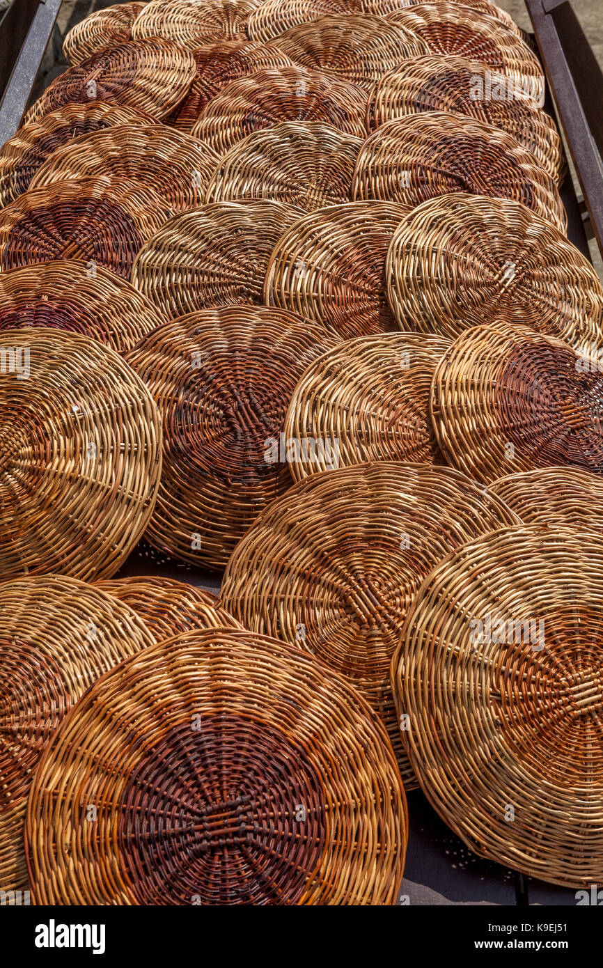 Stacks of round reed woven picnic plate holders & Stacks of round reed woven picnic plate holders Stock Photo ...