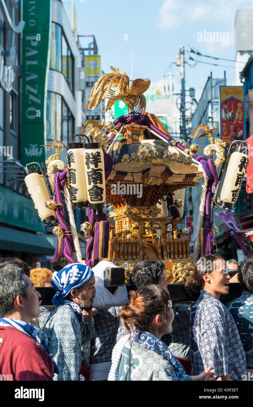Mikoshi procession of the Kichijoji Autumn Festival (Aki Matsuri) of  Musashino Hachimangu Shrine on Heiwa Dori, Kichijoji, Japan