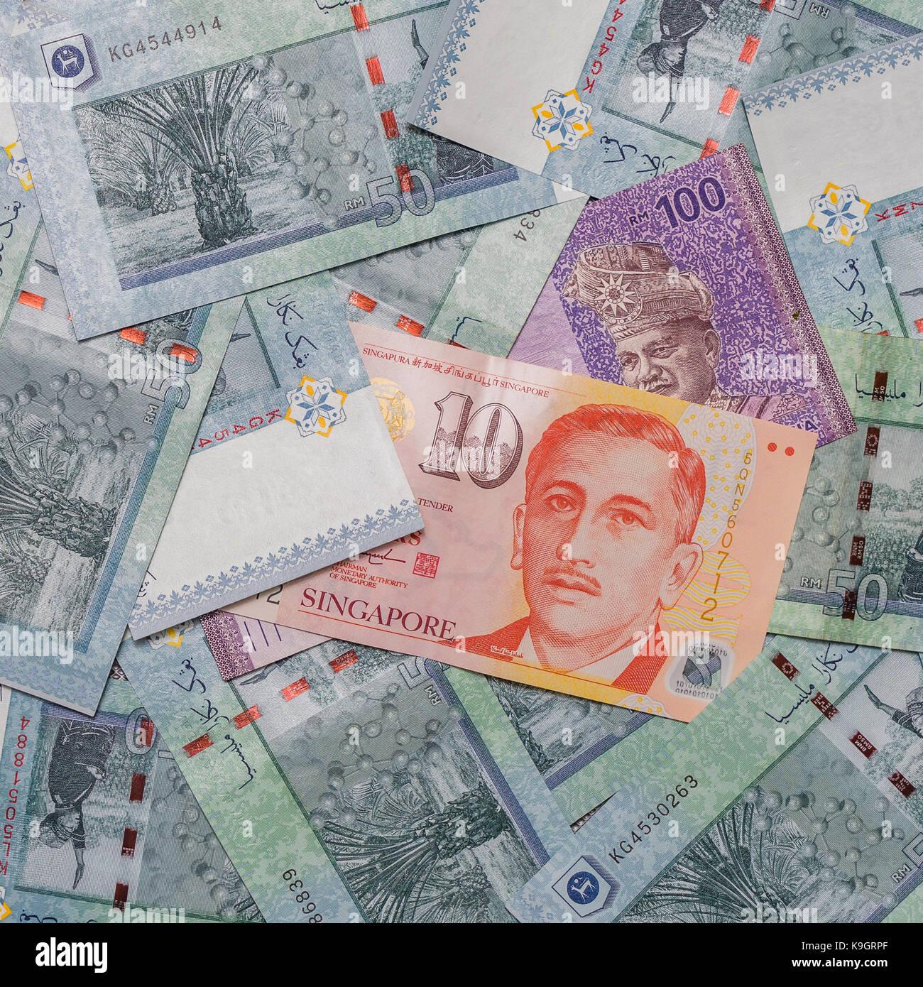 Singapore dollar on top of malaysian ringgit currency on pattern singapore dollar on top of malaysian ringgit currency on pattern background symbol rm currency code myr biocorpaavc
