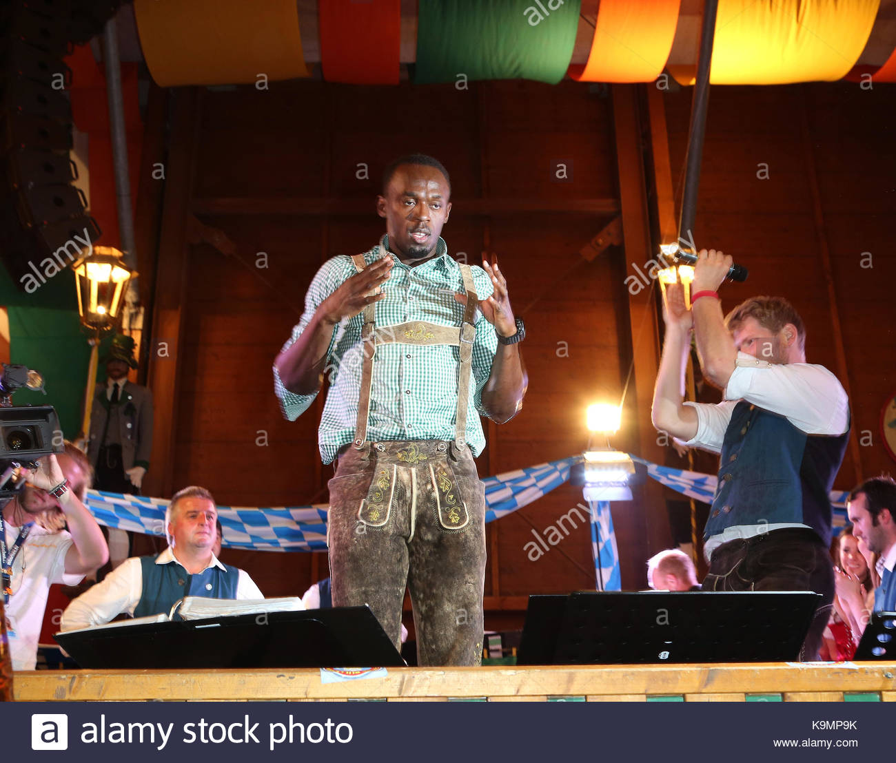 Fastest man on earth Usain Bolt visits the Schuetzen-Tent at the original traditional Oktoberfest in Munich Germany & Usain Bolt. Fastest man on earth Usain Bolt visits the Schuetzen ...