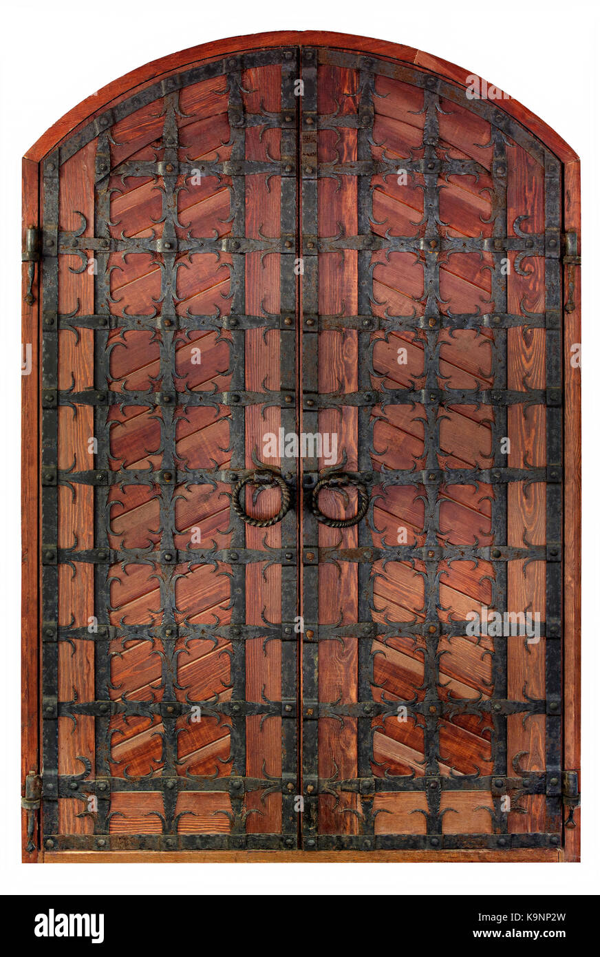 Antique wooden antique wooden doors with a forged iron grille and ...