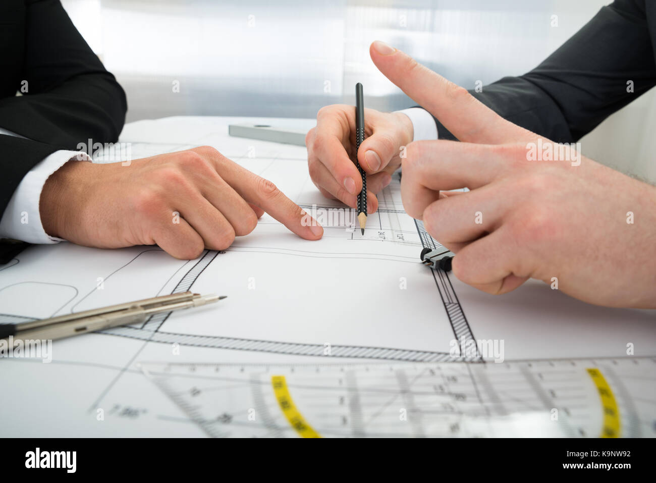 Close up of two architects planning project on blueprint stock photo close up of two architects planning project on blueprint malvernweather Gallery