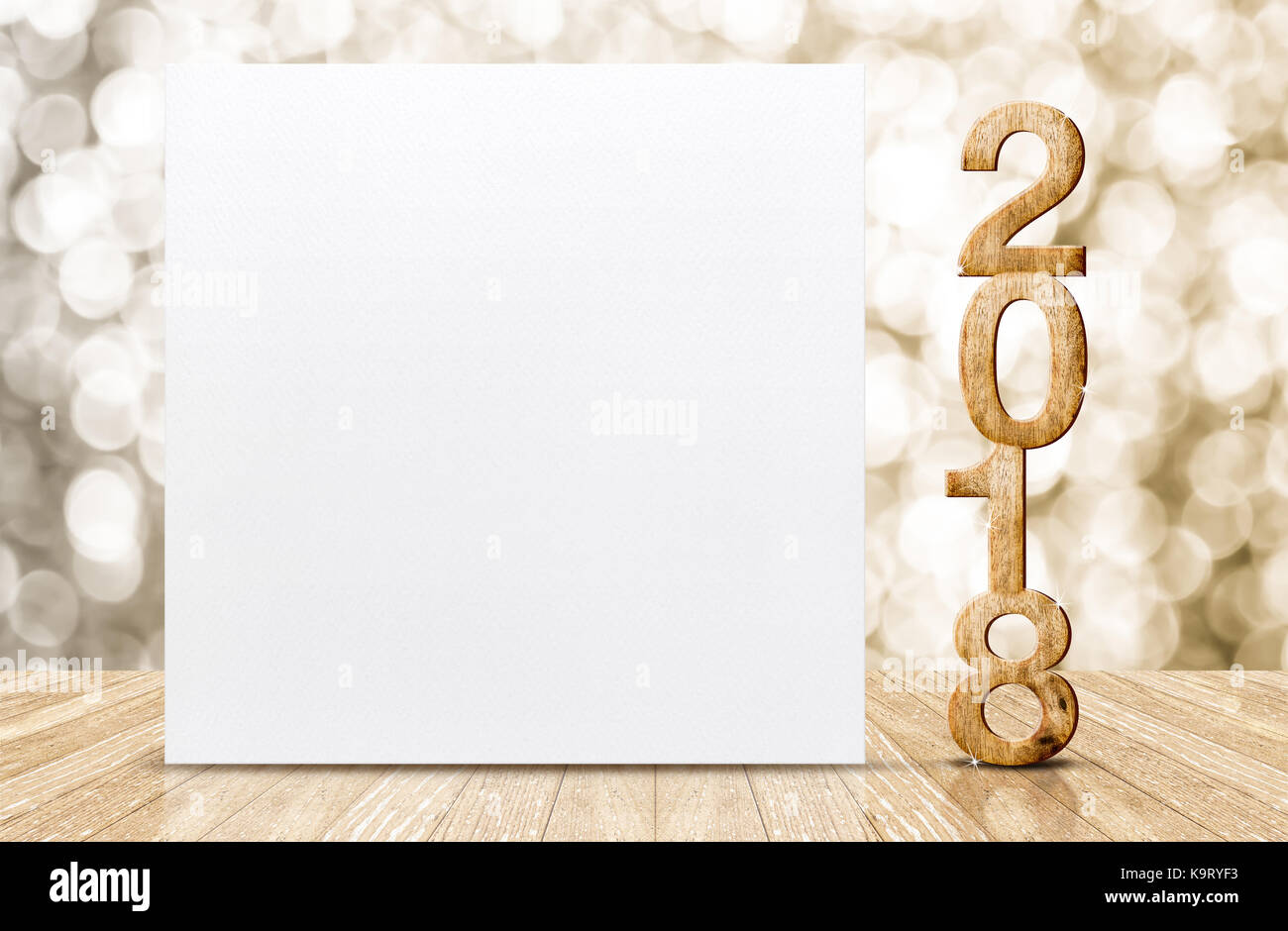 2018 happy new year glitter number and white card in perspective room with sparkling gold bokeh wall and wooden plank floorleave space for adding tex