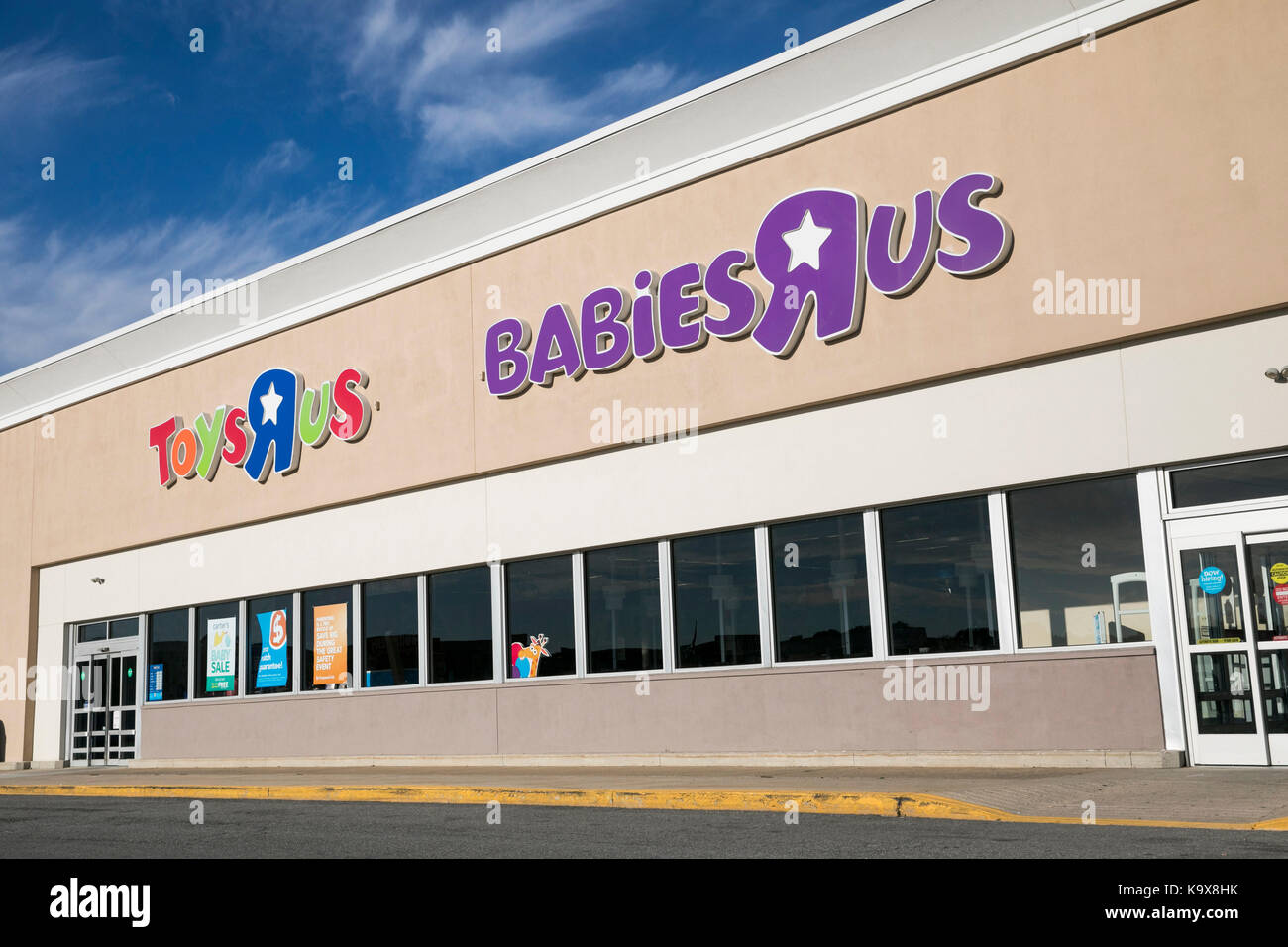 A Logo Sign Outside Of A Toys R Us And Babies R Us Retail Store
