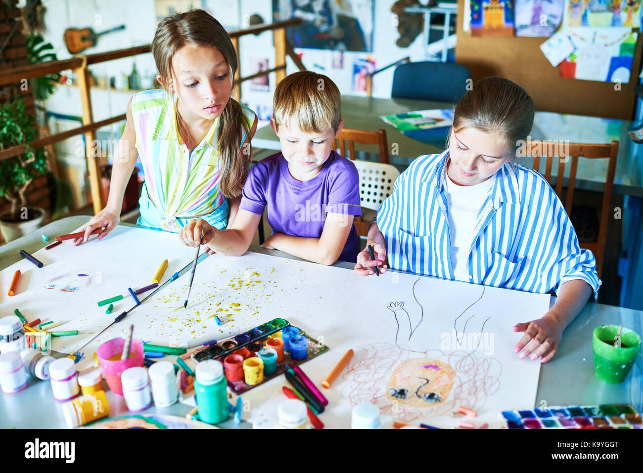Kids painting class stock photos kids painting class for Kids painting classes