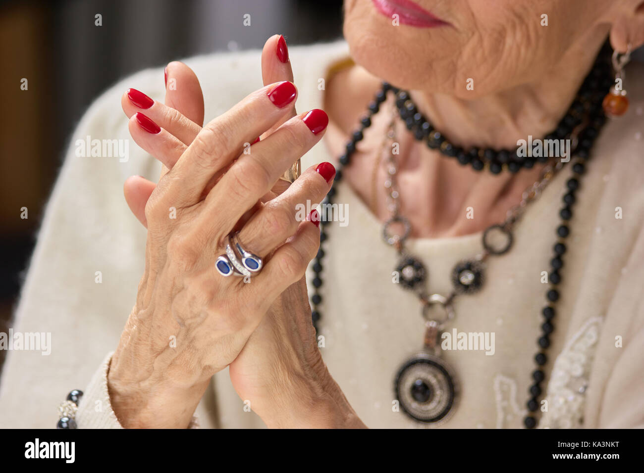 Senior woman luxury with manicure. Luxury old woman with red nails ...