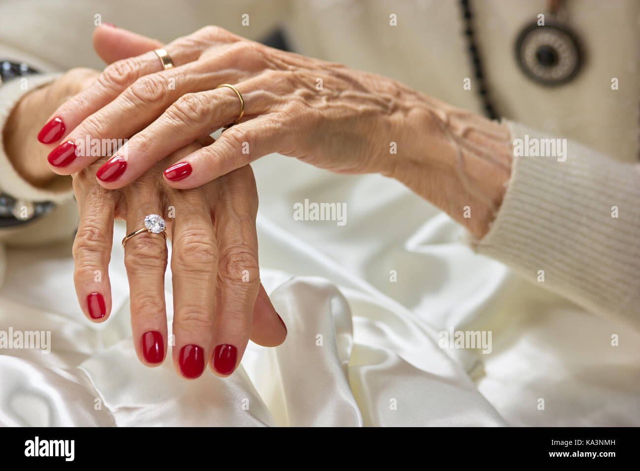 Old woman beautiful hands with rings. Female aged hands with red ...