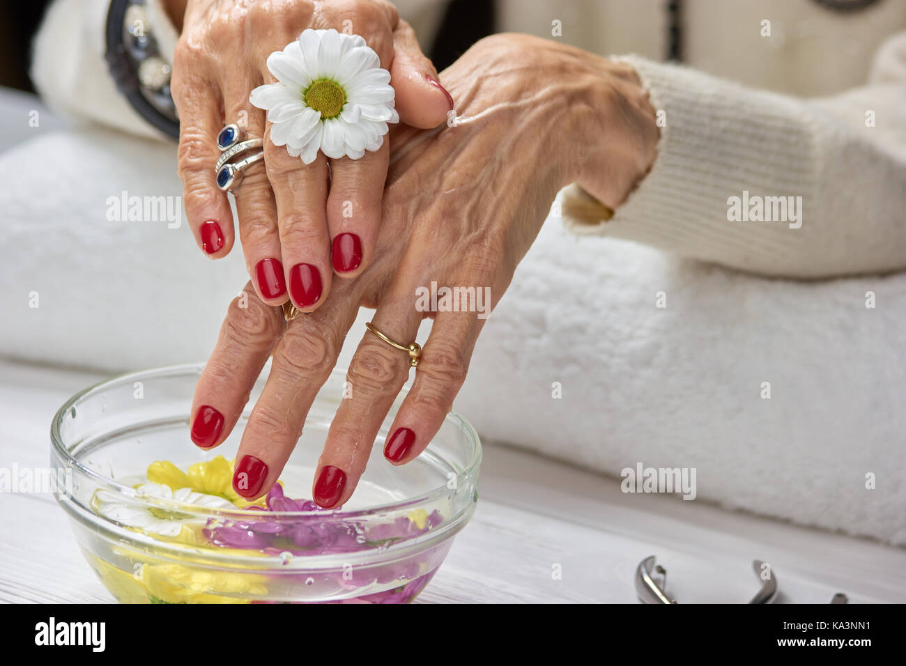Woman with manicure in spa salon. Female hands with bowl of aroma ...
