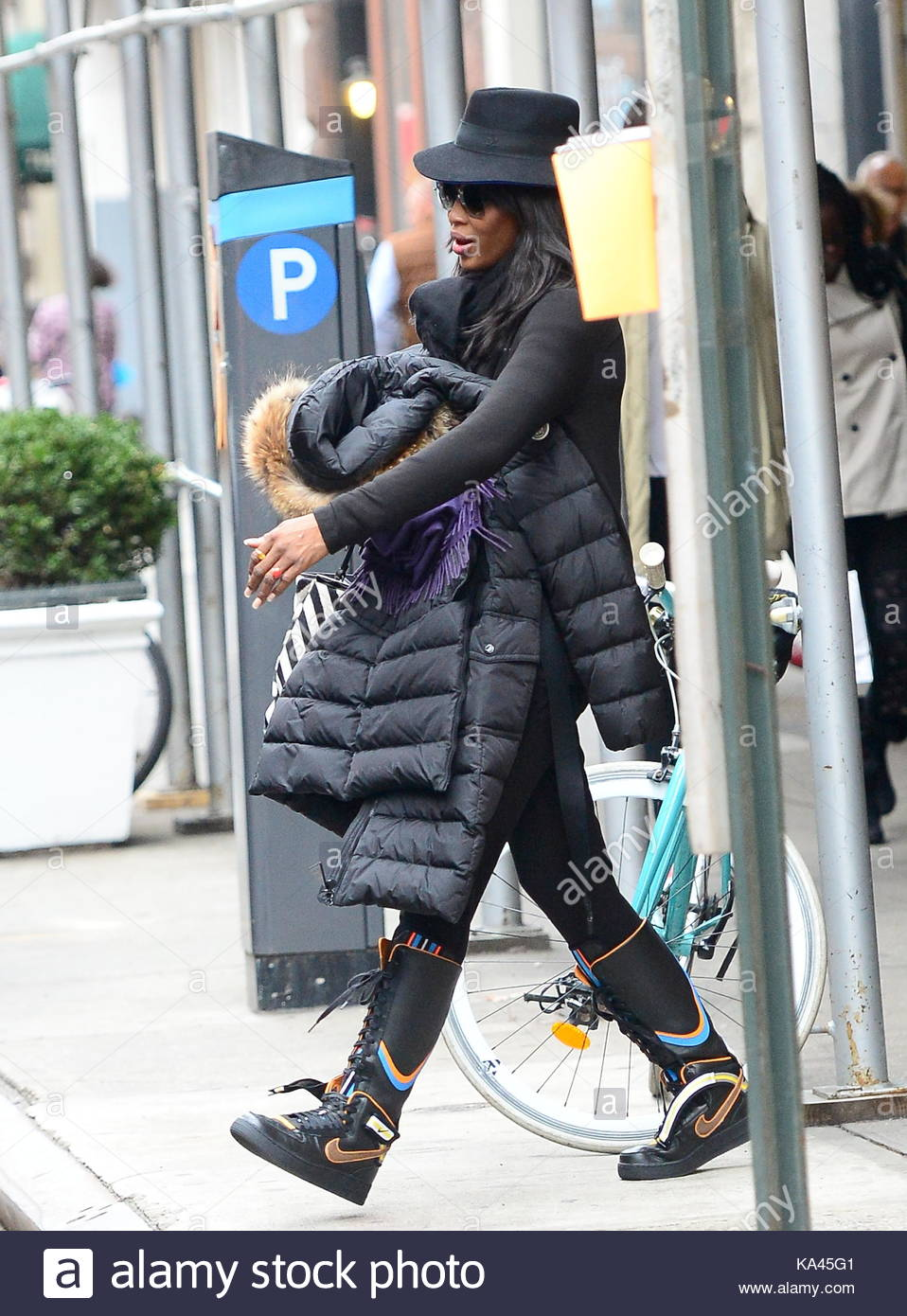 Stock. Naomi Campbell. Naomi Campbell rocks Nike shoes and a black dress in  NYC.