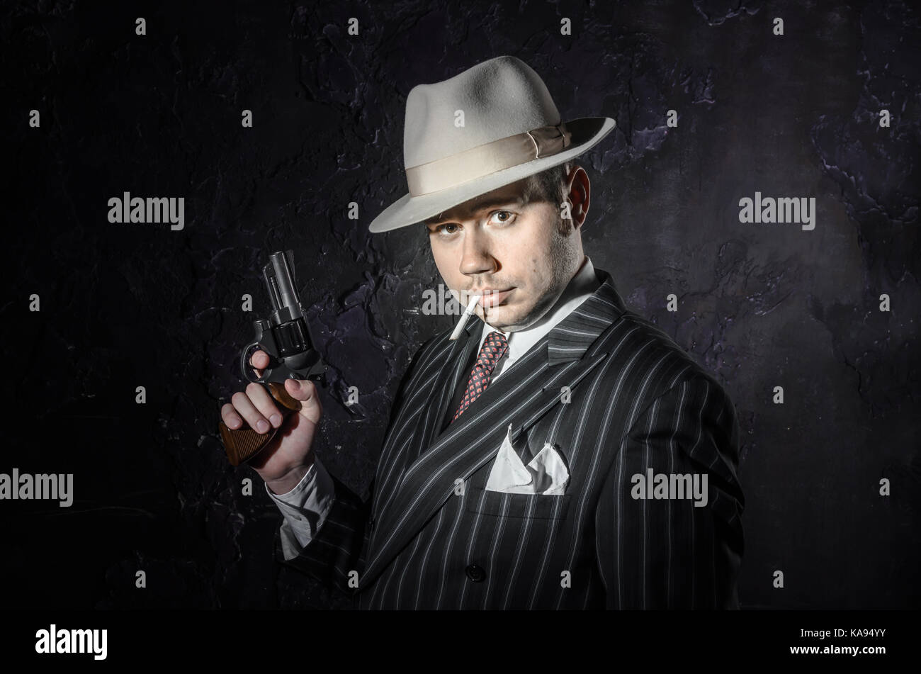 7024d67df Private detective in old fashion hat smokes a cigarette. Gangster ...