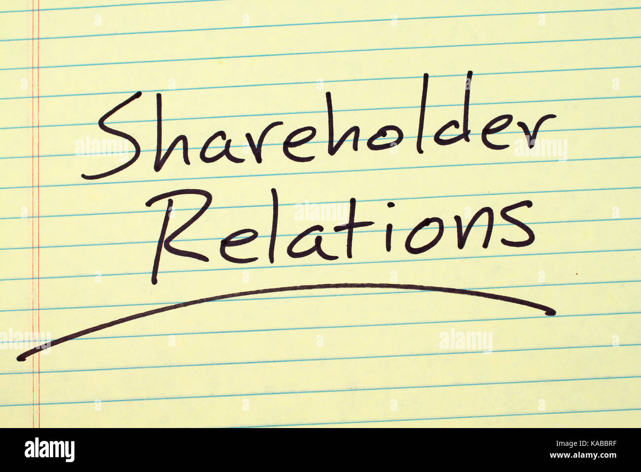Investor relations stock photos investor relations stock images the word shareholder relations underlined on a yellow legal pad stock image kristyandbryce Images