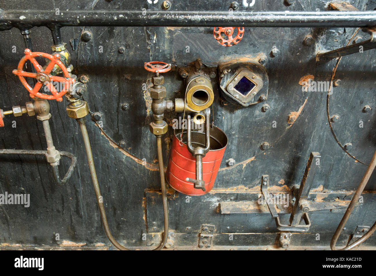 Valves and pipes in vintage steam engine room of WWII Liberty Ship ...