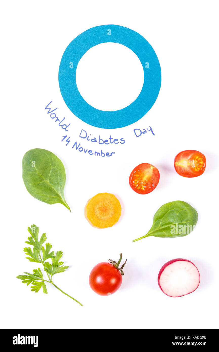 Fresh vegetables and blue circle of paper as symbol of world fresh vegetables and blue circle of paper as symbol of world diabetes day and fighting disease concept of healthy nutrition biocorpaavc