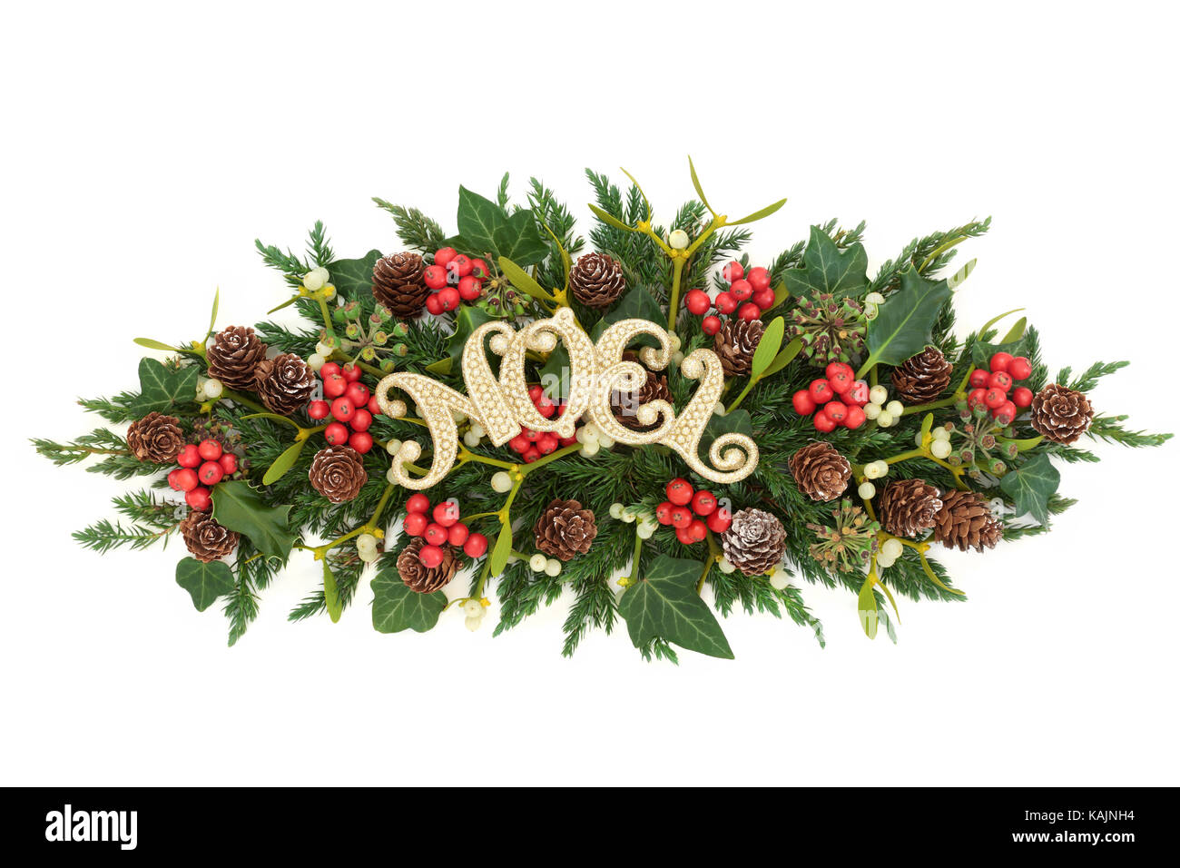 christmas decoration with gold noel sign holly ivy mistletoe fir and pine cones on white background