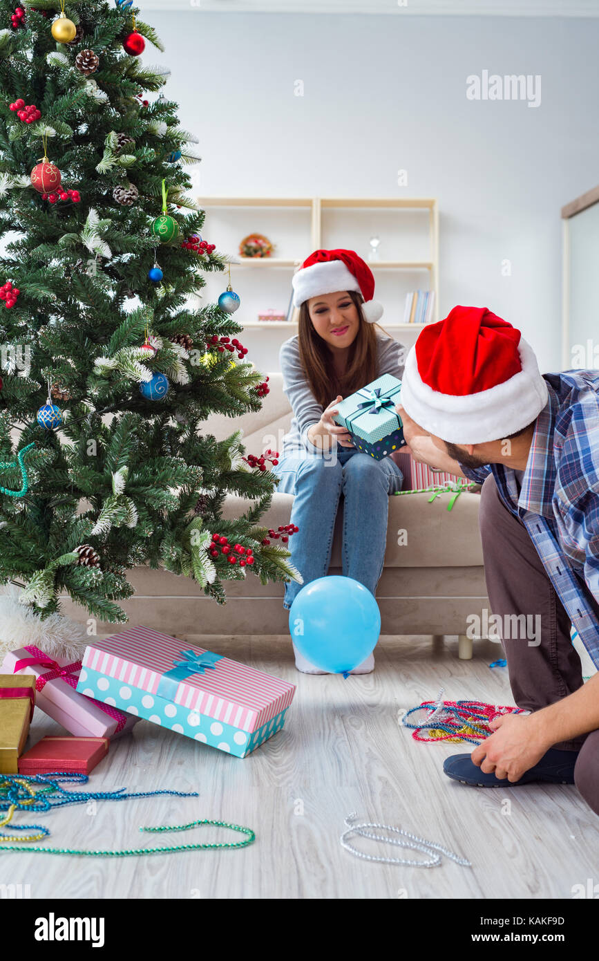 Girlfriend and boyfriend opening christmas gifts stock photo