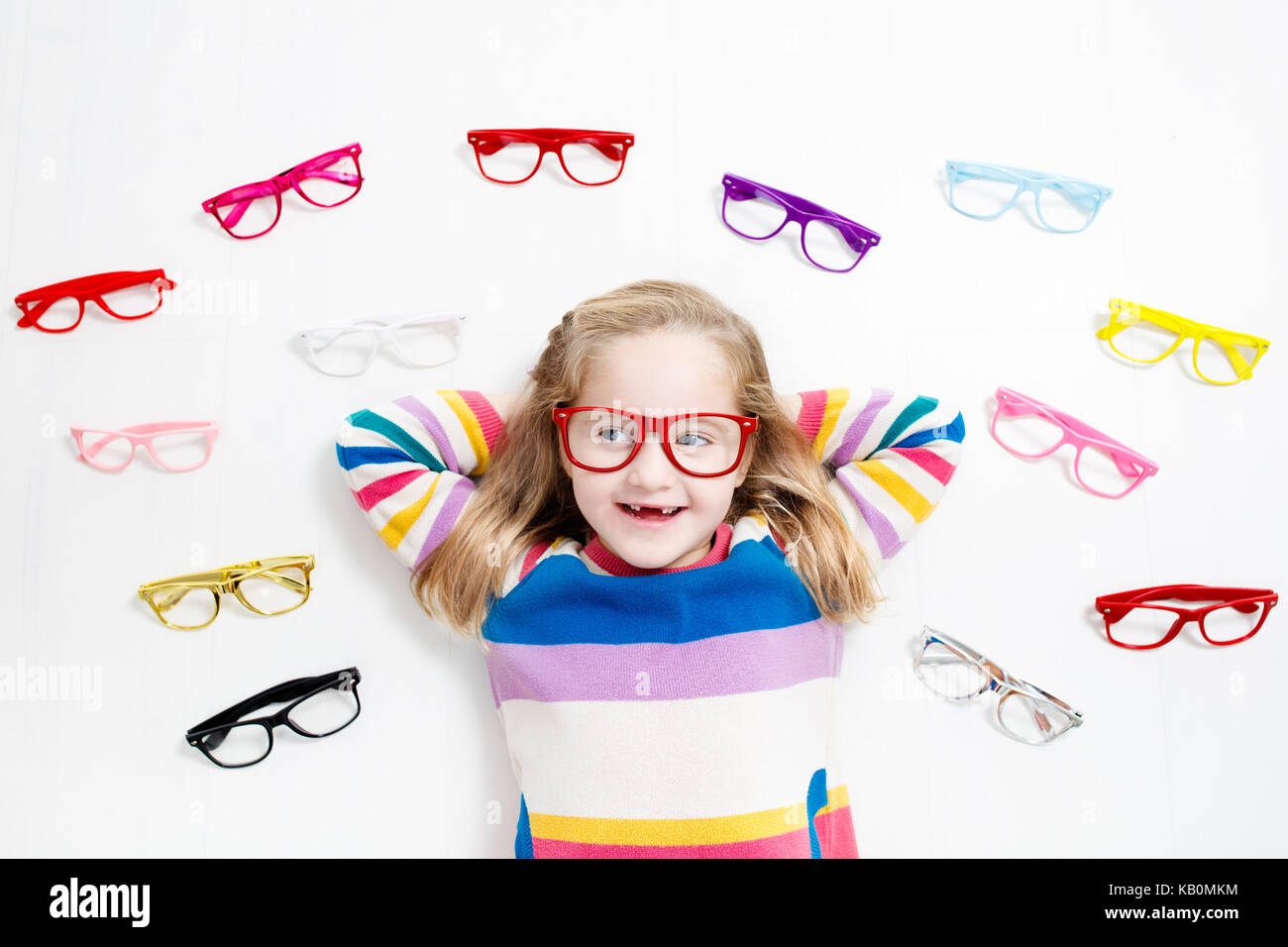 6972bfa64d Child at eye sight test. Little kid selecting glasses at optician store. Eyesight  measurement for school kids. Eye wear for children. Doctor performin