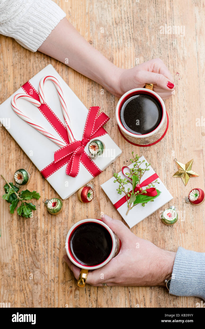 Romantic Christmas Morning Couple With Coffee Candy Canes And Gifts Portrait And Landscape Orientation With Room For Copy