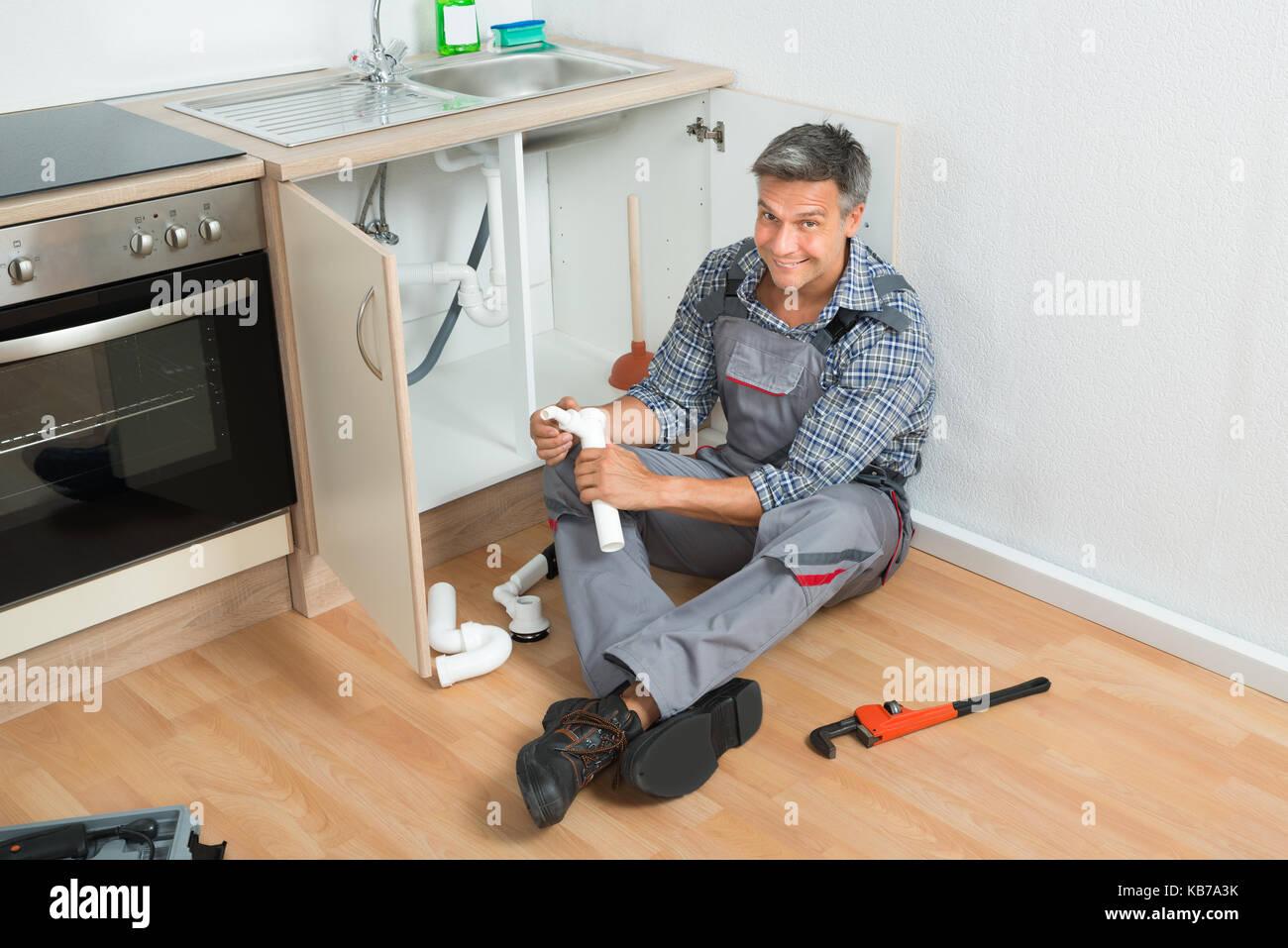 Mature plumber