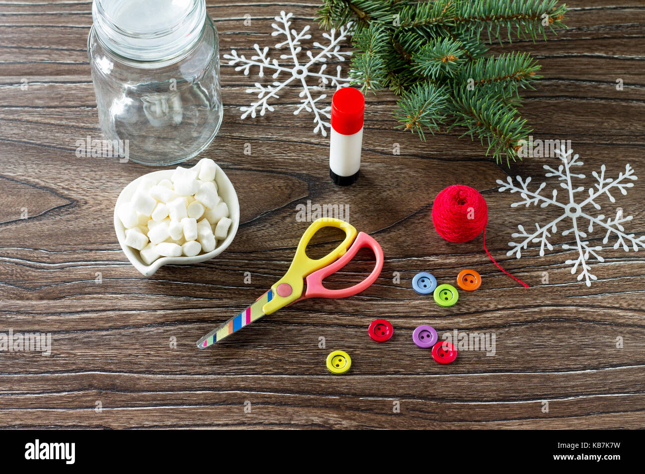a child is making a christmas present with a snowman of sweets made by own hands childrens art project for children craft for kids copy space for