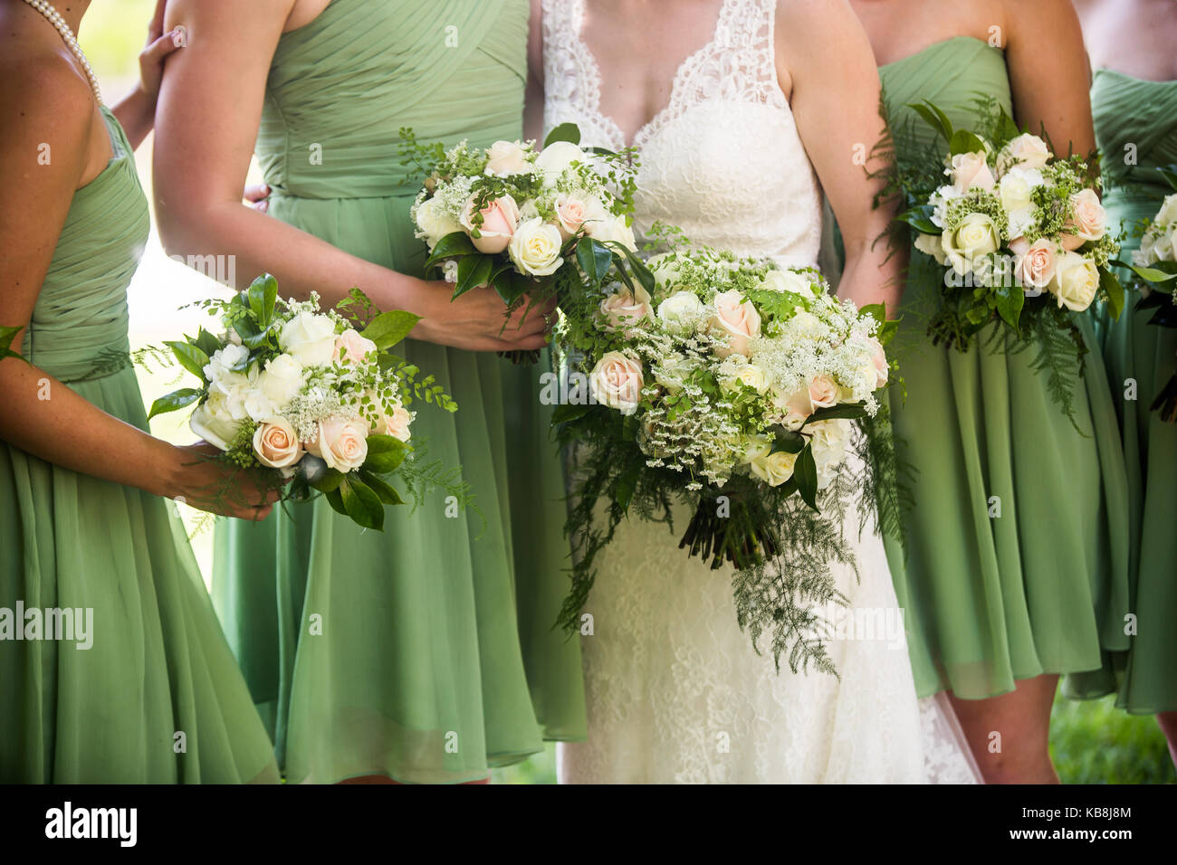 A candid photo of bride and her bridesmaids wearing light green a candid photo of bride and her bridesmaids wearing light green bridesmaid dresses and holding a ombrellifo Gallery