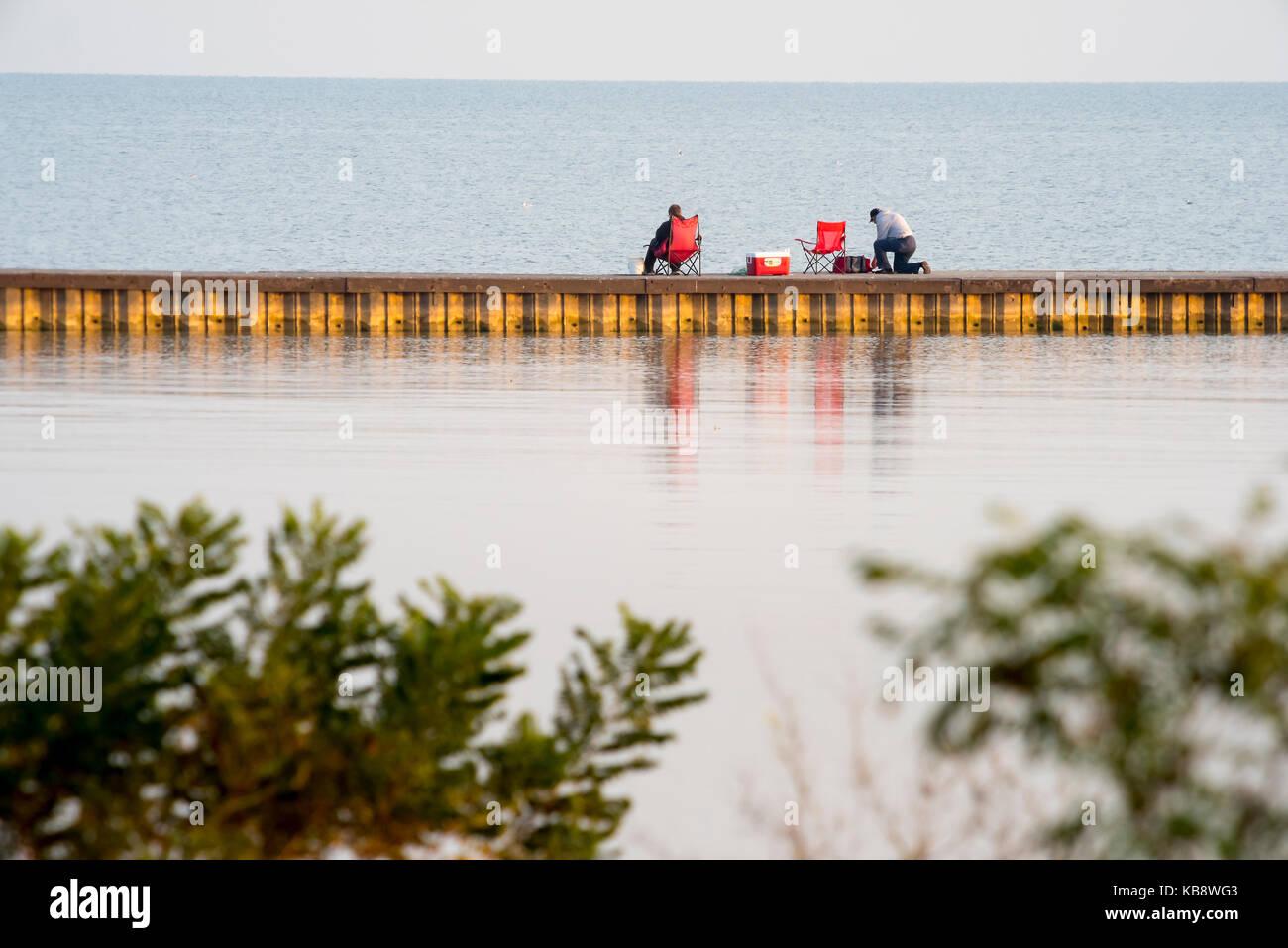 Pair men fishing stock photos pair men fishing stock for Lake erie pier fishing