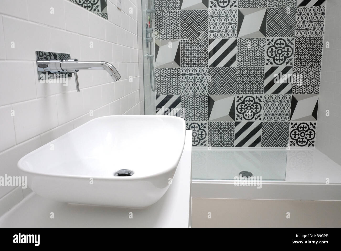 Scandi style white bathroom with monochrome patchwork tiles Stock ...