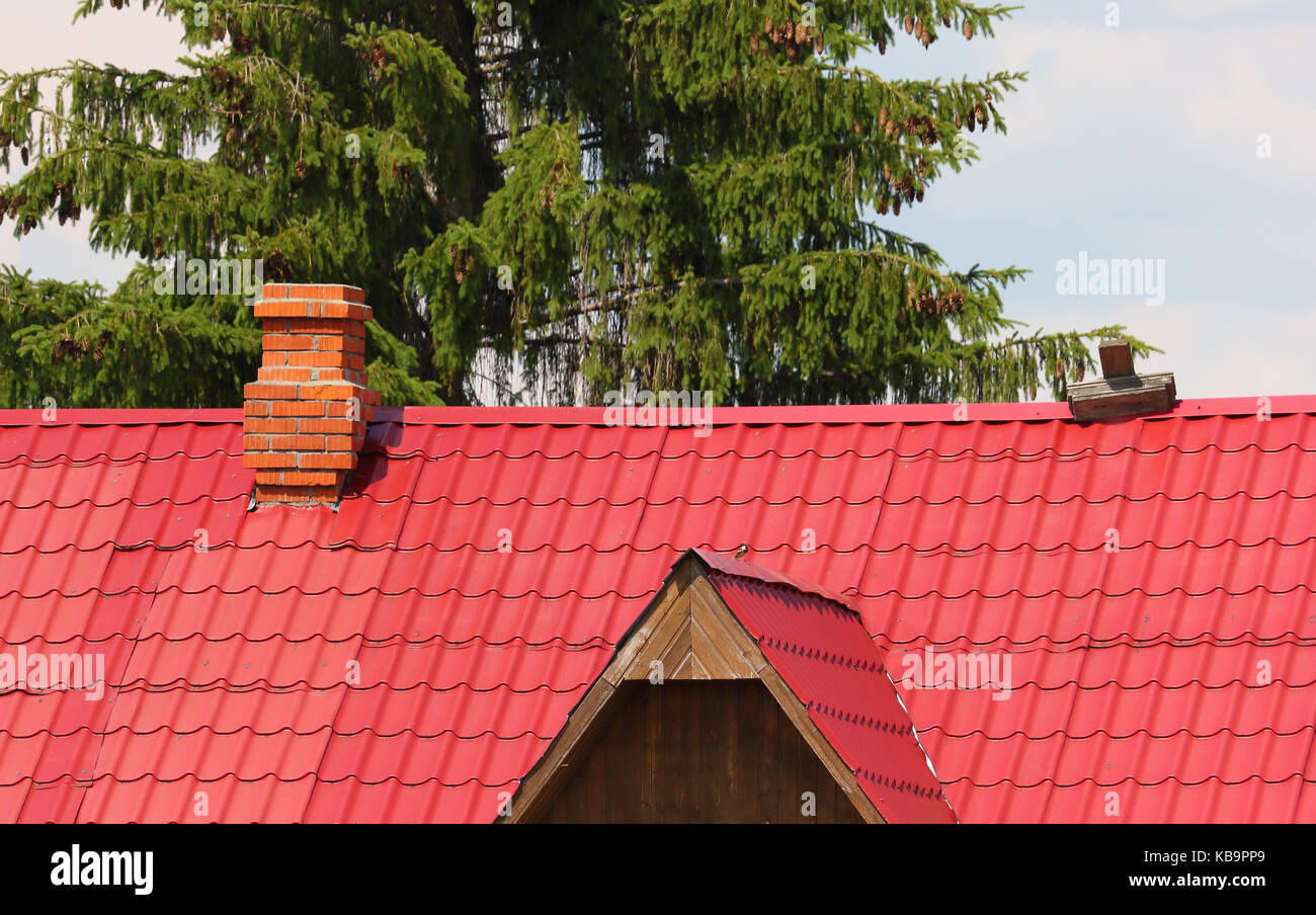 Brick Chimney On The Red Metal Roof Photo   Stock Image