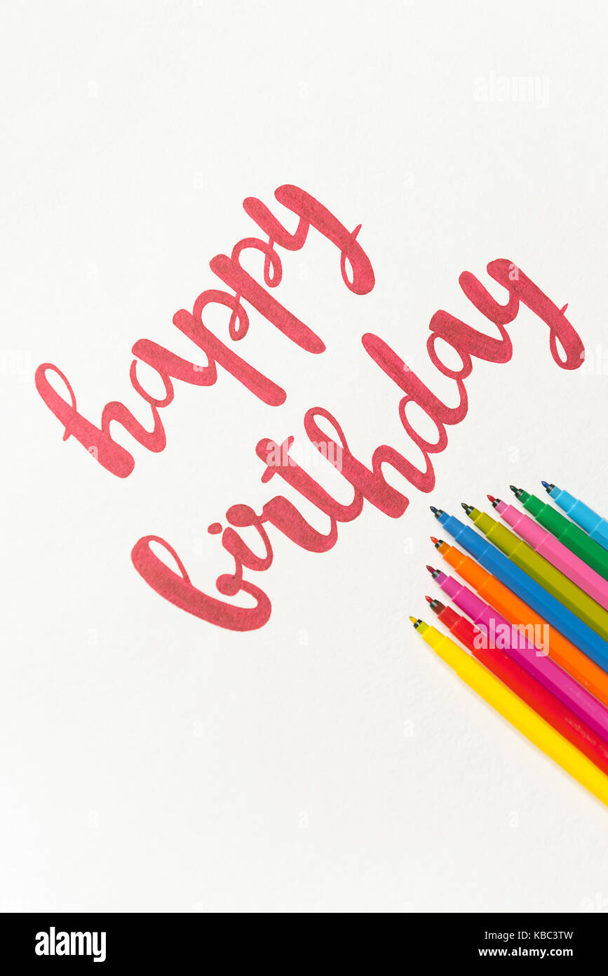 Colourful phrase happy birthday for greeting cards and posters colourful phrase happy birthday for greeting cards and posters drawing with red marker on white paper top view of lettering bunch of colourful mar m4hsunfo