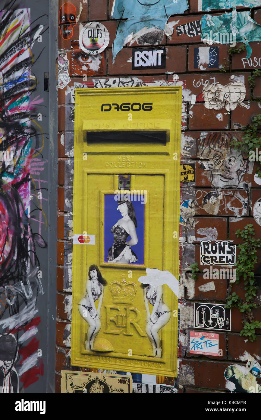 Wall art and yellow letter box in Hanbury Street East London Stock ...