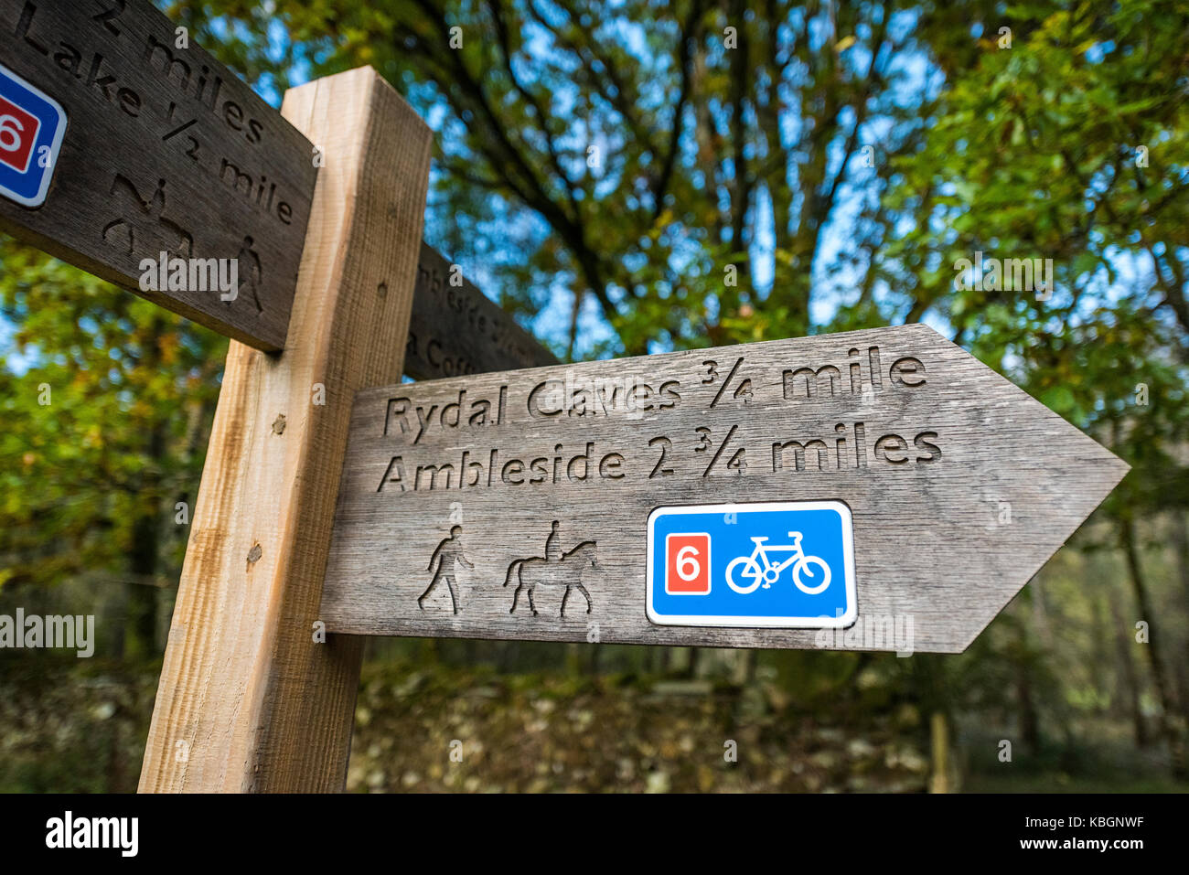 wooden signpost directions to rydal cave ambleside lake stock photo