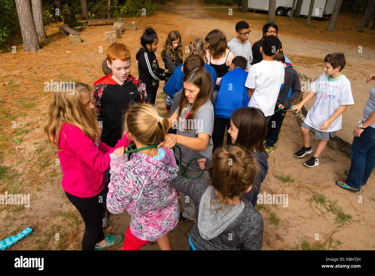 Kids Use A Rope To Learn Team Building Skills And Other
